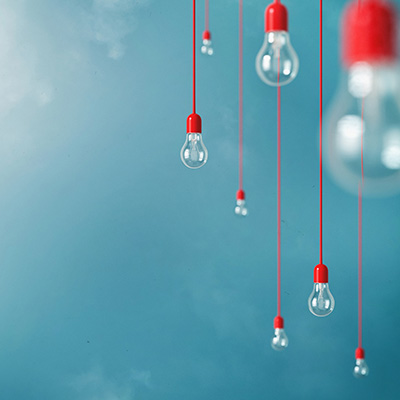Photo of Hanging light bulbs with depth of field. Modern art